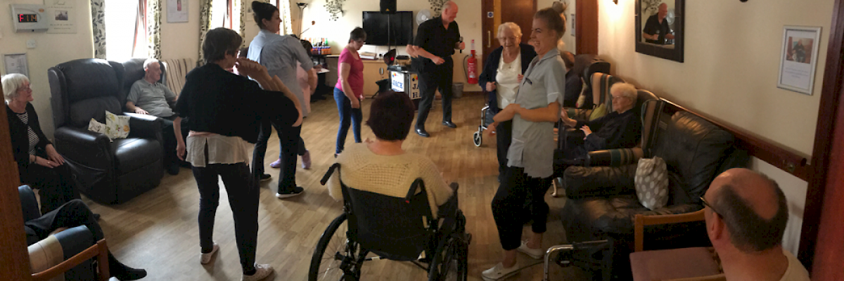 Residents & staff from Coll, Barra & Arran House enjoying an afternoon of singing.
